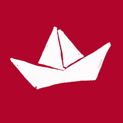Paper sailing boat on a red background